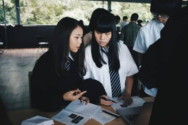 two students discuss classwork