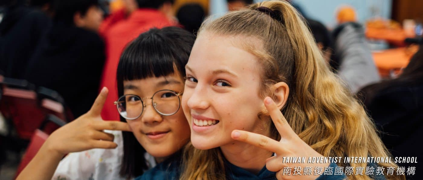 two girls smile for the camera